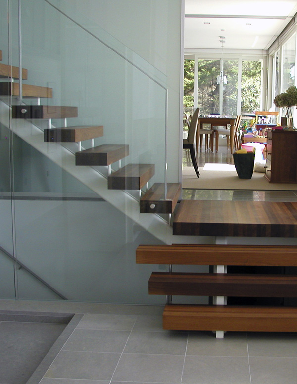 Our custom treads with glass wall and steel by others