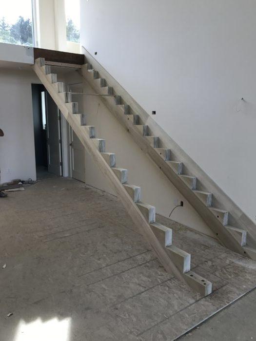 Custom 20′ poplar stringers mid-installation